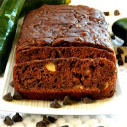 Chocolate Chip Zucchini Bread Recipe - Moist chocolate zucchini bread is full of chopped nuts and chocolate chips. Nobody will guess this easy treat is made with a green veggie. Recipe makes 2 loaves.