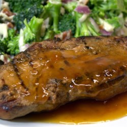 Marinated Pork Roast With Apricot Sauce Recipe - A marinated pork loin roast is served with sweet apricot sauce for a main dish that's fit for company.