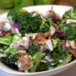Creamy Broccoli Salad Recipe - Broccoli, bacon, and mozzarella cheese are tossed in a creamy dressing for a perfect picnic salad.