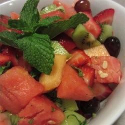 Summer Fruit Salad with a Lemon, Honey, and Mint Dressing Recipe - Get many tastes of summer in a single watermelon fruit salad, mixing strawberries, peaches, nectarines, pears, and grapes in a lemon and mint dressing.