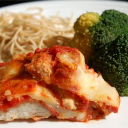 Chicken Parmigiana Recipe - Breaded chicken is baked with spaghetti sauce and cheese in this tasty, family-friendly chicken parmigiana dish.