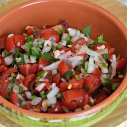 Pico De Gallo de Alicia Recipe - This fresh tomato salsa brings the heat thanks to the liberal use of fresh jalapeno pepper.