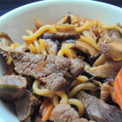 Beef Sukiyaki Recipe - Vegetables, noodles, and beef are served in a steaming, flavorful broth made with dashi, mirin, and soy sauce in this Japanese dish, sukiyaki.