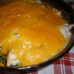 Saucy Chicken and Asparagus Bake Recipe - Chicken breasts bake with asparagus in a creamy sauce with Cheddar cheese for an easy supper.