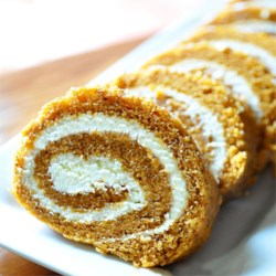 Grandma Carol's Pumpkin Roll Recipe - A pecan and cream cheese filling is rolled into this pumpkin spice cake for a festive holiday dessert.