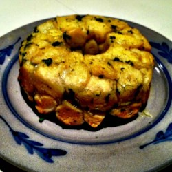 Savory Monkey Bread Recipe - This savory version of monkey bread is flavored with onion, parsley, and dill.