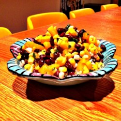 Mango, Corn, and Black Bean Salsa Recipe - Canned corn and black beans get tossed with fresh mango, cilantro, and lime juice for an easy salsa.