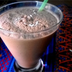 Mocha Coffee Cooler Recipe - Coffee, non-dairy creamer, and cocoa give this refreshing, icy-cold drink a classic mocha flavor.