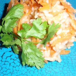 Pumpkin-Carrot Rice Recipe - This savory, bright Caribbean recipe for brown rice, pumpkin, and carrots is seasoned with garlic and a touch of cloves, and is a nice side dish to serve with pork.
