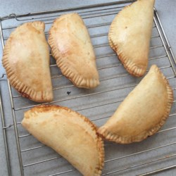 Mexican Pumpkin Empanadas Recipe - Fat little Mexican-style pastries stuffed with sweet pumpkin filling make a great snack or a take-along breakfast.