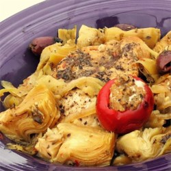 Spicy Mediterranean Chicken with Sausage-Stuffed Cherry Peppers Recipe - This combination of chicken thighs, artichoke hearts, olives, pepperoncini, and spicy sausage-stuffed peppers creates a bold Mediterranean flavor.