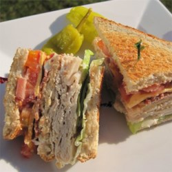 Lorraine's Club Sandwich Recipe - A triple-decked sandwich with bacon, turkey ham, lettuce and tomato.