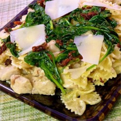 Mascarpone Pasta with Chicken, Bacon and Spinach Recipe - Rich, creamy mascarpone cheese is not just for desserts. Here it enriches a sauce full of chicken and crumbled bacon served over bow-tie pasta and topped with lightly cooked spinach.