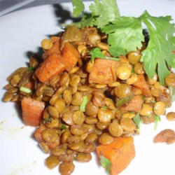 Caribbean Curried Peas (Lentils) Recipe - Caribbean-inspired lentils are spiced with ginger, curry powder, and a chile pepper for a side dish that will keep you warm!