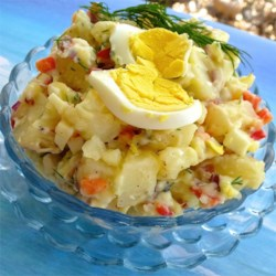 Potato Salad Dressing I Recipe - This is a cooked creamy dressing with a sweet and mustard taste that works beautifully when folded into cooked potatoes. It makes two cups, enough for a big batch of your favorite spud salad.