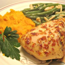 Honey-Dijon Chicken With A Kick Recipe - Chicken breasts are sprinkled with red pepper flakes and baked in a mixture of Dijon mustard and honey for a simple and tasty weeknight dish.