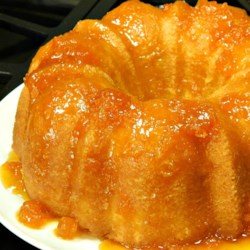 Apricot Brandy and Peach Schnapps Pound Cake Recipe - This rich cake soaked in a liqueur syrup serves 12 generously.  Serve with fresh peaches and blueberries in the summer, or with a simple dollop of creme fraiche during the winter months.