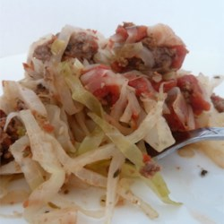 Ground Beef and Cabbage Recipe - A simple, homey dish of cabbage cooked with tomatoes and ground beef with a few simple seasonings will remind you of home.