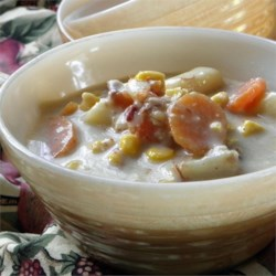 Ham Bone Chowder Recipe - Leftover ham bones are a perfect addition to potato and corn chowder in the slow cooker for a warm and comforting weeknight dinner.