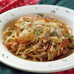 Left Over Spaghetti Lasagna Recipe - Get the flavor of lasagna with the easiest layered baked spaghetti dish ever. Just mix cooked thin spaghetti with prepared sauce, layer with cottage cheese, sprinkle with mozzarella cheese, and bake. It's a perfect way to use up left-over spaghetti.