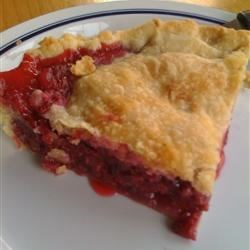 Raspberry Pie I Recipe - This is a wonderful double-crust pie piled high with fresh raspberries. The berries are sugared and sprinkled with tapioca and cornstarch, and arranged in a prepared crust. Pats of butter go on just before the top crust is added, and then the pie is baked until the juices bubble up and the crust is golden brown.