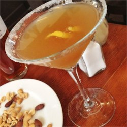 Sidecar Cocktail Recipe - The Ritz Hotel in Paris claims to have created this cocktail in the early 20th century. The potent combination of Cognac and orange-flavored liqueur shaken until ice cold with lemon juice is a timeless classic.