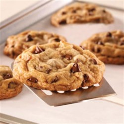 Tiffany's Chocolate Chip Cookies Recipe - Classic chocolate chip cookies bake up browned and tender on sheets of parchment paper.
