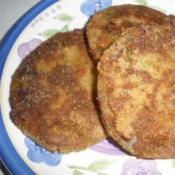 Easy Southern Fried Green Tomatoes Recipe - Cornmeal-coated green tomato slices are fried until crisp and golden. They're perfect as a southern appetizer or for a unique take on a classic B.L.T.