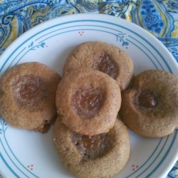 Raspberry Molasses Crinkles Recipe - A molasses thumbprint cookie filled with raspberry jam makes a different addition to the cookie tray.