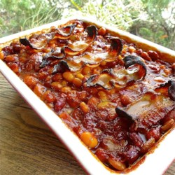 Bar-B-Q Baked Beans Recipe - This dish is a bonanza of baked beans! Chili sauce adds a little spiciness. Don't be dissuaded by the lima beans - they blend into the mix wonderfully!