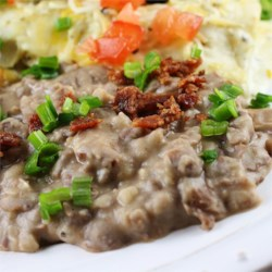 Rush Hour Refried Beans Recipe - Quick and easy refried beans can be made in 20 minutes. Simply combine pan-fried onion and garlic with mashed pinto beans and cumin for a flavorful side dish.