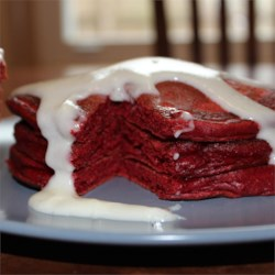 Red Velvet Pancakes with Cream Cheese Glaze Recipe - These red pancakes drizzled with a frosting-like glaze will make any breakfast special.
