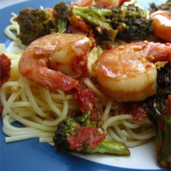 Shrimp, Broccoli, and Sun-dried Tomatoes Scampi with Angel Hair Recipe - For a quick and full-flavored dish, saute garlic in a mixture of butter and the rich oil from sun-dried tomatoes, then add the tomatoes and lots of fresh shrimp. Serve this heady mixture over angel hair pasta cooked with broccoli florets.