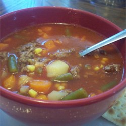 Home-Style Vegetable Beef Soup Recipe - Ground beef is simmered with diced red potatoes, corn, green beans and carrots in tomato-vegetable juice cocktail in this easy soup.