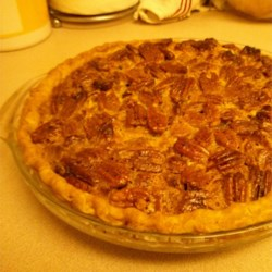 2-Layer Rum Pecan Pie with Cheesecake Recipe - Pecan pie with a layer of cheesecake and a double crust on the bottom is a new twist on the traditional pecan pie.