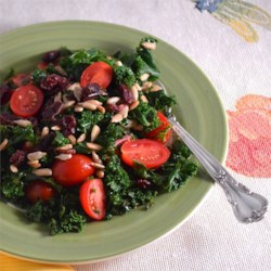 Kale Salad Recipe - Hearty kale makes a delicious green salad with sunflower seeds and dried cranberries.
