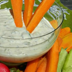 Green Goddess Dip Recipe - Sour cream and mayonnaise are the base of this dip with anchovy fillets and fresh herbs.