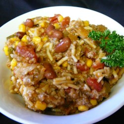 Mexican Venison Skillet Recipe - Ground venison, kidney beans, tomatoes, and corn combine with boxed Spanish Rice mix for a quick one-dish meal with a mild Mexican flavor.  It is perfect for kids and folks who are picky about deer meat!