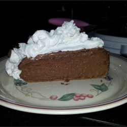 Doubly Decadent Dark Chocolate Cheesecake Recipe - This creamy chocolate cheesecake is topped with chocolate whipped cream for a double chocolate treat.