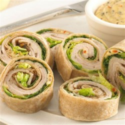 Boar's Head(R) Ovengold(R) Turkey Pinwheels Recipe - Try these turkey pinwheels for a quick appetizer with flair.