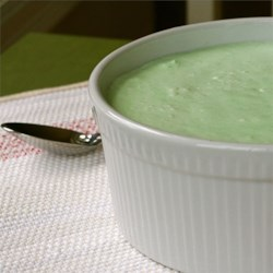 Sea Foam Salad Recipe - A pretty pale green salad made with lime Jell-O, Cool Whip, cream cheese, and canned pears.