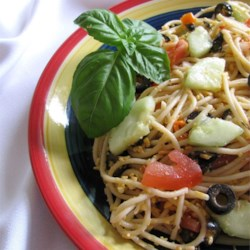 Nancy's Spaghetti Salad Recipe - Spaghetti is tossed with a variety of vegetables and Cheddar cheese and flavored with Italian dressing for a filling lunch or hearty side dish.