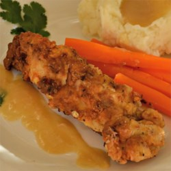 Country Fried Chicken Recipe - Chicken breasts are pounded thin and marinated overnight in a savory buttermilk brine. Seasoned flour makes the crispy coating even more delicious.