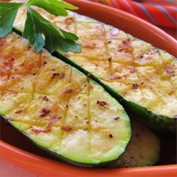 Easy Grilled Zucchini Recipe - With just a bit of  olive oil and grill seasoning, you can have a delicious zucchini side dish ready in less than 30 minutes.