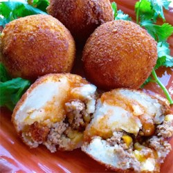 Papas Rellenas (Fried Stuffed Potatoes) Recipe - Garlic, cumin, and tomato flavor the beef filling inside these stuffed potato balls.