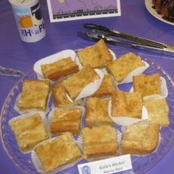 Southern Chess Squares Recipe - A yellow cake and pecan crust is topped with a rich cream cheese filling, then cut into squares for easy serving.