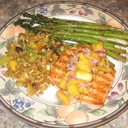 Grilled Salmon with Curried Peach Sauce Recipe - This salmon steak is grilled with a sweet, simple peach sauce. It can also be baked.