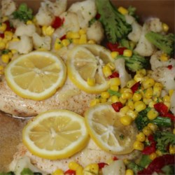 Healthier Easy Baked Tilapia Recipe - Tilapia is quick and easy to prepare. This flavorful dish uses fresh garlic and lemon to highlight the natural flavor of the fish. Accompanied by cauliflower, broccoli, and red pepper - you have a colorful and satisfying meal.