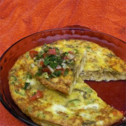 Chile Cheese Squares Recipe - What begins as a cheese omelet soon transforms into spicy appetizer squares. Simple to make and simply delicious. Cut the baked mixture into little square servings.