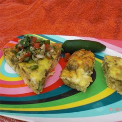 Jalapeno Cocktail Squares Recipe - Just three easy ingredients--eggs, cheddar and chiles--make a baked strata-like snack that's served with a fork or toothpicks.